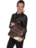 HAIR ON CALF AND LEATHER HANDBAG.  TOP ZIP CLOSURE.  EXTERIOR FRONT ZIP POCKET.  INTERIOR ZIP AND TWO OPEN POCKETS.  SIZE: 11 INCH X 12 INCH X 1 INCH.