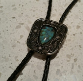 "Jade Arrowhead Stone Inlaid in a Antique Silver and Black Frame with Four 1/8"" crystals Bolo Tie"