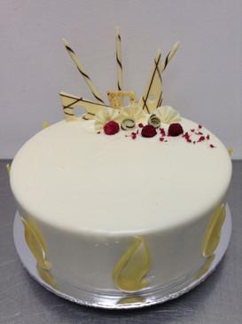 Elegant White Chocolate and Raspberry Mud Cake