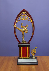 "13"" Trophy with Kicking Figurine and Year Ornament"