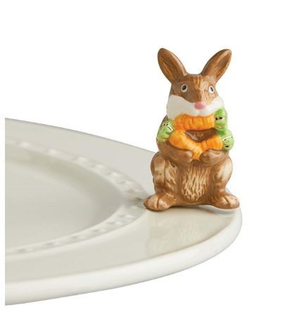 """Nora Fleming's New """"Funny Bunny"""" mini shows a bunny with an armload of carrots - and one in his mouth! Adorable for Easter, spring celebrations, and perfect any time of the year for any Nora Fleming serving piece or platter."""