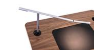 Grommet mount secures light to desk