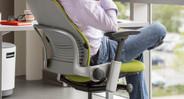 Progressive back slat system improves chair airflow