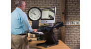 The HealthPostures TaskMate Executive 6100 Desk Converter features a built-in mouse platform