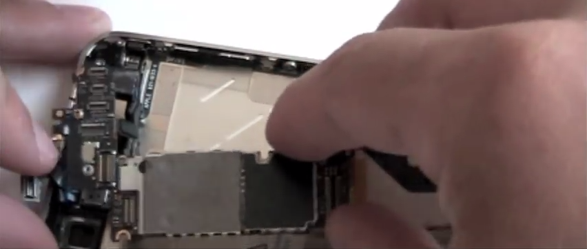 Take the plates off the water damaged iPhone 4 logic board