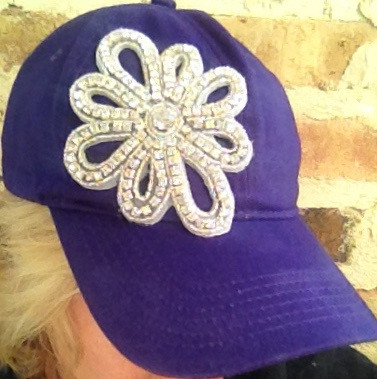 Beautiful baseball style cap appliqued with full rhinestone embellishment. Comes n any team color! This will be your new Fav to wear out to the ballpark! Adjustable back closure with opening in back for ponytails!