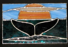 Hawaiian Whale tail stained glass hanging.