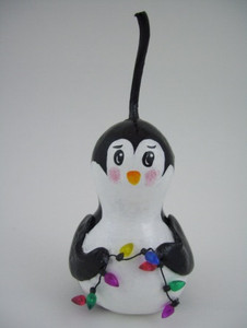 Hand-painted penguin ornament. Made in New York.