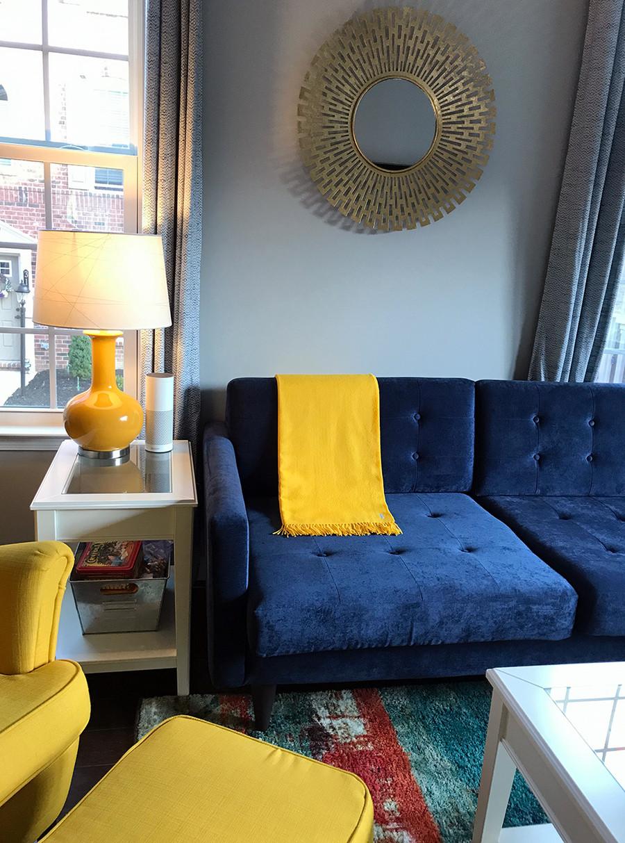 Classic Throw - 100% Baby Alpaca Forsythia on Navy Couch