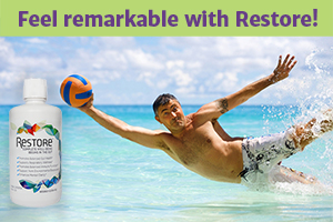 "Older man airborne in the surf of clean ocean water, to hit a volleyball;also a bottle of Restore For Gut Health and the words ""Feel remarkable with Restore!""."