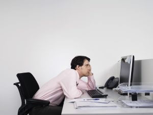 Improve your posture by standing more at work.
