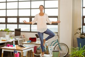 Yoga at your desk will help with stress.