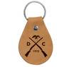 """Dark Tan, genuine leather keychain (approx 3"""" x 2.25"""") with the duck guns graphic etched into the front. Color may vary and subject to change overtime."""