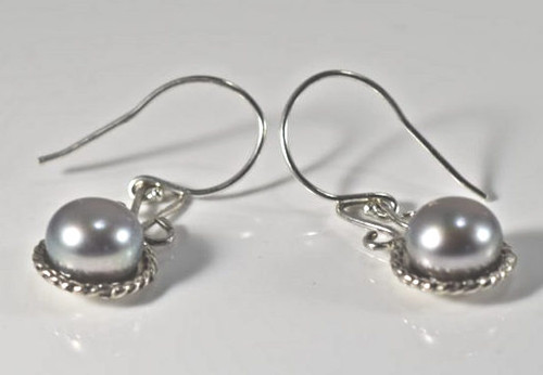 The grey pearl rope edge drops are hand crafted in Portland, Maine.  The earrings have a sterling silver rope edge and a swirl style drop.