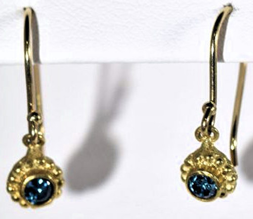 The beaded blue diamond drops are hand crafted in Portland, Maine.  The diamonds are 2.7 mm. in diameter and are round brilliant cuts, with an dark turquoise blue color and are heat treated.  The stones are bezel set in 18 k yellow gold beaded bezel.  They are on 14 k yellow gold hooks.  The earrings weigh 1.4 grams and have a solid back and dangle down 19 mm.