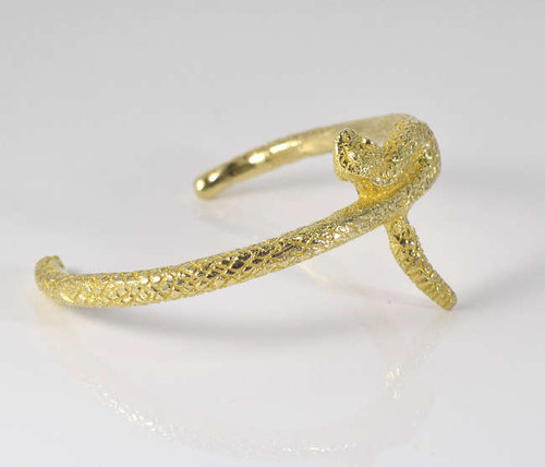 The gold plated brass small snake cuff is hand crafted in Portland, Maine.  The bracelet is a three dimensional rattle snake and weighs 27.9 grams.  This cuff fits an average wrist. The bracelet measures 1.5 x 2.5 x 2 inches.