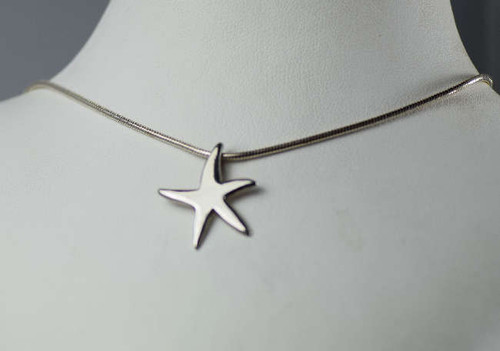 The medium plain starfish pendant is sterling silver.  This pendant has a polished finish and is hand crafted with a hidden bail.  The pendant weighs 1 gram and measures 20 mm. x 17 mm.