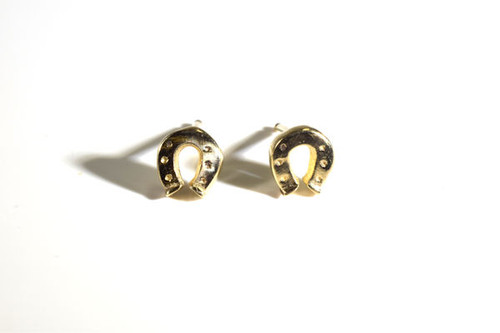 The small gold horse shoe stud earrings are hand crafted in Portland, Maine.  The horse shoe has a polished finish, are solid,  and weighs 2.2 grams.  The earrings  3/8 x 5/16  x 3/8 inch. The earrings are 14 K yellow gold.
