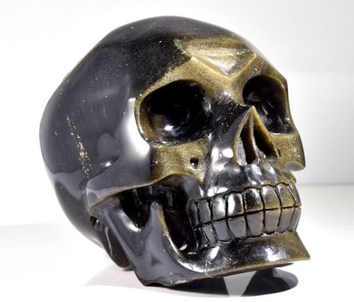 The gold sheen obsidian skull is wonderfully carved.  The contrast is very good.  The skull has a high polish.  This skull measures 3.75 x 5 x 3.2 inches.
