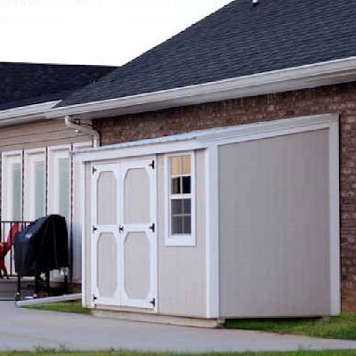 Shown in the 6x10 size with optional double barn-style doors and window, with Light Gray painted siding, White painted trim, and Alamo White metal roof.