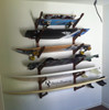 triple surfboard storage rack with skateboards and wakeboards