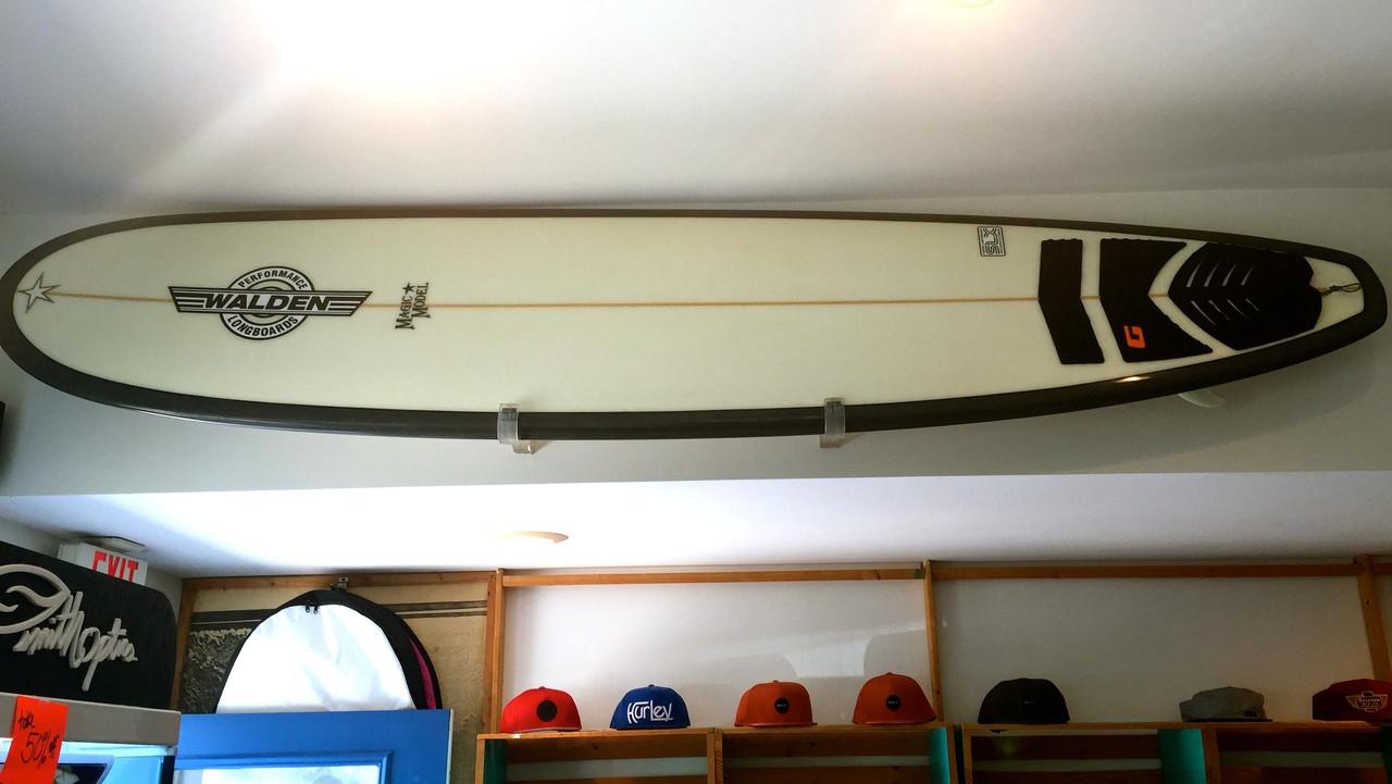 clear surfboard rack retail surf shop