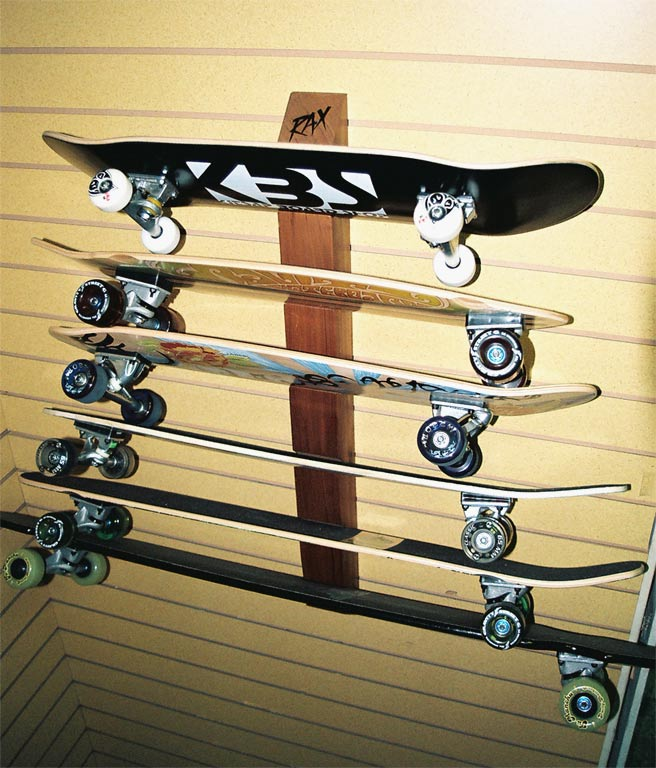 environmentally friendly skateboard rack that can hold 6 skateboards.  hardwood skateboard wall rack