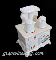 """This is a miniature ceramic vintage stove. A wonderful addition to your vintage stove top or to your vintage kitchen. There are 4 pieces, the stove separates from the main stove, the 2 coffer/tea pots also come off. Fill the inside with coffee, tea, sugar, or.... There is normal paint wear, there are no cracks or chip. This is a wonderful piece!  APPROX. MEASUREMENTS: Wide 4.5""""   Height 5.25"""""""