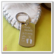 Stainless steel Birth Announcement Keychain, showing details and footprints