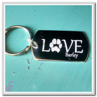 Stainless steel Double Love Pawprint Keychain. This is the front, the back is the same design with the second pet's paw and name