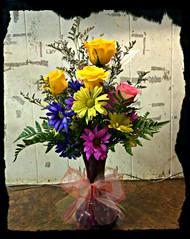 Sweet compilation of bright colored daisies and roses sure to lighten the mood