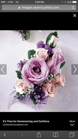 """Large roses and spray roses with accent flowers on elastic wristband.  PICKUP ONLY!  Note any color changes and pickup time in notes. To upgrade to bracelet - select 'Premium"""" upgrade and  note black, white pearl, rose gold, silver diamond, gold diamond."""
