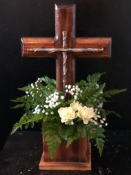 Beautiful Ozark's handcrafted cross and planter box accented with fresh greens, babies breath and roses.