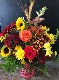 Colorful fall collection of roses, mums, carnations, daisies, sunflowers and snapdragons, sure to brighten up someone's life