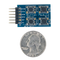 Size comparison product image of the Pmod BTN: 4 User Pushbuttons and a US quarter (diameter of quarter: 0.955 inches [24.26 mm]; width: 0.069 inches [1.75 mm]).