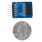 Size comparison product image of the Pmod DA1: Four 8-bit D/A Outputs and a US quarter (diameter of quarter: 0.955 inches [24.26 mm]; width: 0.069 inches [1.75 mm]).