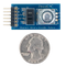 Size comparison product image of the Pmod ENC: Rotary Encoder and a US quarter (diameter of quarter: 0.955 inches [24.26 mm]; width: 0.069 inches [1.75 mm]).