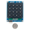 Size comparison product image of the Pmod KYPD: 16-button Keypad and a US quarter (diameter of quarter: 0.955 inches [24.26 mm]; width: 0.069 inches [1.75 mm]).