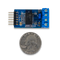 Size comparison product image of the Pmod RS485: High-speed Isolated Communication and a US quarter (diameter of quarter: 0.955 inches [24.26 mm]; width: 0.069 inches [1.75 mm]).