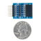 Size comparison product image of the Pmod TPH: 6-pin Test Point Header and a US quarter (diameter of quarter: 0.955 inches [24.26 mm]; width: 0.069 inches [1.75 mm]).