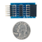 Size comparison product image of the TPH2: 12-pin Test Point Header and a US quarter (diameter of quarter: 0.955 inches [24.26 mm]; width: 0.069 inches [1.75 mm]).