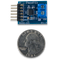 Size comparison product image of the Pmod TC1: K-Type Thermocouple Module and a US quarter (diameter of quarter: 0.955 inches [24.26 mm]; width: 0.069 inches [1.75 mm]).
