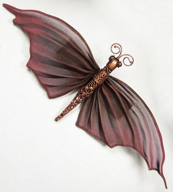 Elegant Moth Pin. This pin is large enough to drape over your shoulder or place on a bag or even your drapes. Have fun. Available in different colors. Please select your base color and then write in your additional colors. You can email us for color options or click on the link to our most popular colors