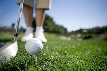 closeup-of-golfer-putting-ball