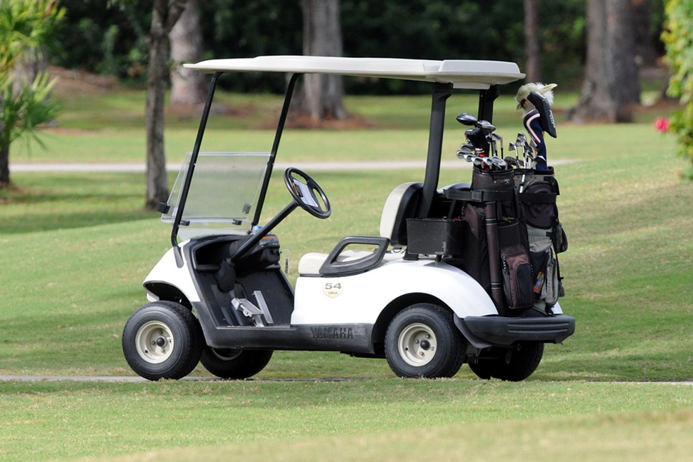golf cart loaded clubs course