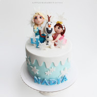 Frozen themed cake with customized figurine