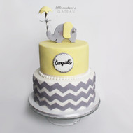 yellow and grey themed baby shower cake with elephant