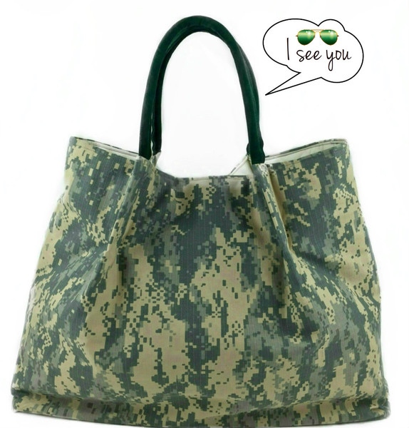 Stylish and strong, this army uniform designer tote is ideal for every season. Available in army green, check out this Lola tote bag today!