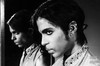 Prince wearing the Moon Ear Wrap. Photograph by Steve Parke titled Moon in the Mirror.