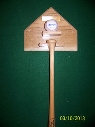 Home  plate with ball and bat holders